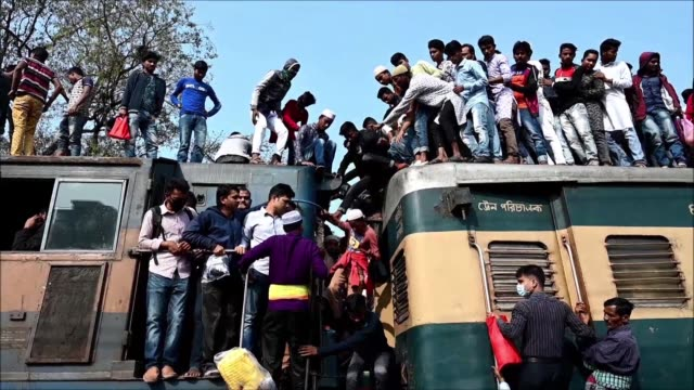 hundreds hop on top of trains as the world's second largest congregation of muslims after the hajj in mecca concludes in bangladesh - hajj stock videos & royalty-free footage