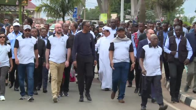 hundreds join a march led by rwandan president paul kagame through the streets of kigali to honor the victims of the rwandan genocide that left more... - ehre stock-videos und b-roll-filmmaterial