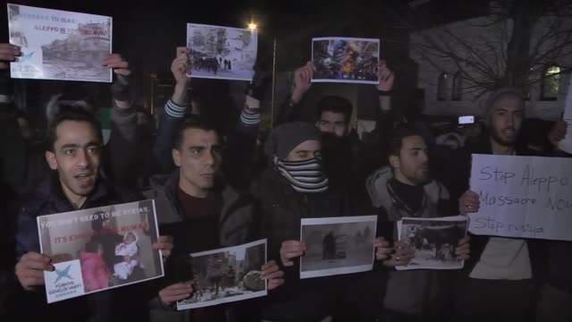Hundreds of activists and a group of Syrian students gather in front of the Iranian embassy in Ankara on December 14 2016 during a demonstration to...
