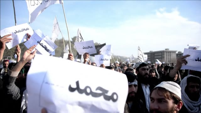 hundreds of afghan university students protest against the french satirical magazine charlie hebdo and its publication of cartoons depicting the... - publication stock videos & royalty-free footage