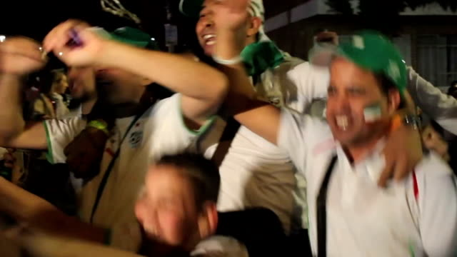 hundreds of algerian soccer fans celebrate the victory of algeria into the second round of the 2014 fifa world cup in the capital algiersjune 26 2014... - brasile meridionale video stock e b–roll