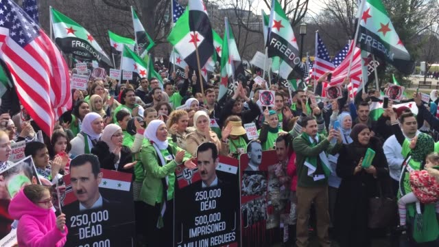 hundreds of antiassad syrians gather in front of the white house in the us capital washington dc and vow to stand against assad regime until syria is... - syrien stock-videos und b-roll-filmmaterial