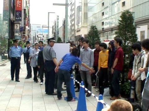Hundreds of Apple fans braved sweltering humidity to form giant queues in an upscale Tokyo district Thursday in a race to be among the first in the...