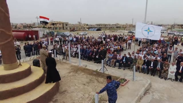 Hundreds of Assyrian Christians who fled as Islamic State took over Qaraqosh 2 years and 3 months ago were greeted with a new 30 CM cross in the...