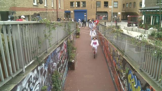 hundreds of bmx riders dressed as easter bunnies take to the streets of london for charity england london ext bmx riders along high angle view of... - happy easter stock-videos und b-roll-filmmaterial