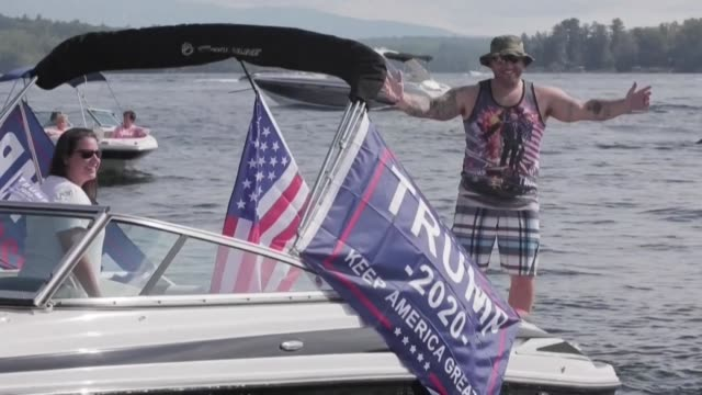 hundreds of boaters parade on lake winnipesaukee in laconia, new hampshire, to support us president donald trump - nautical vessel stock videos & royalty-free footage