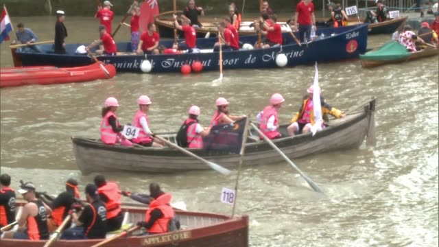 hundreds of boats take part in the great river race on the river thames england london docklands ext various of different shapes and sizes of rowing... - itv london tonight weekend stock videos & royalty-free footage