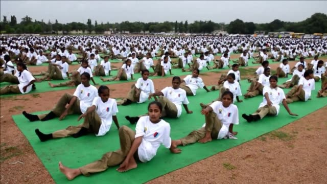 hundreds of cadets in secunderabad mark world yoga day with an open air class - kadett stock-videos und b-roll-filmmaterial