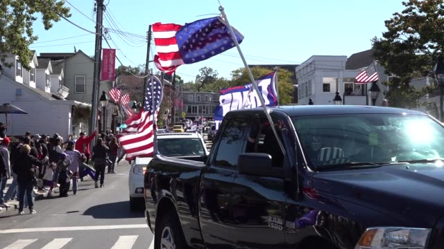 hundreds of cars and trucks with trump flags roll through port jefferson long island ny to cheers of 'trump 2020' qanon conspiracy theorist speakers... - orthographic symbol stock videos & royalty-free footage