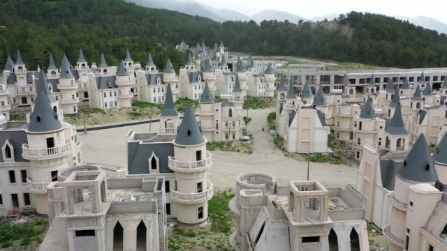 hundreds of castle like villas and houses are seen unfinished at the burj al babas housing development on may 21 2019 in mudurnu turkey construction... - fülle stock-videos und b-roll-filmmaterial