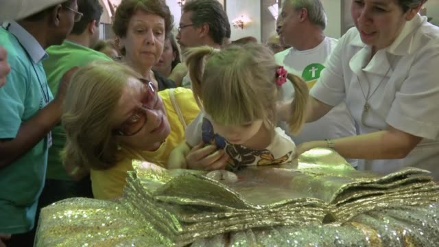hundreds of catholics gathered sunday in a church of rio de janeiro to see a reliquary containing the blood of pope john paul ii on display in brazil... - pope john paul ii stock videos and b-roll footage
