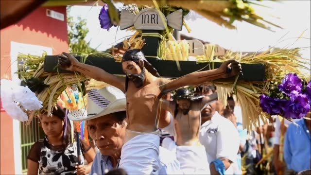 hundreds of catholics participated in a holy week ceremony in the indigenous town of izalco el salvador walking for around 16 hours while carrying... - holy week stock videos & royalty-free footage