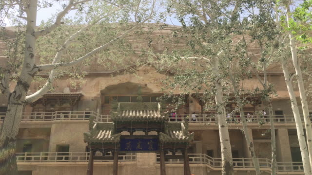 Hundreds of caves with Buddhist statues and wall paintings were cut into a cliff of two kilometers long The Mogao Caves also known as the Thousand...