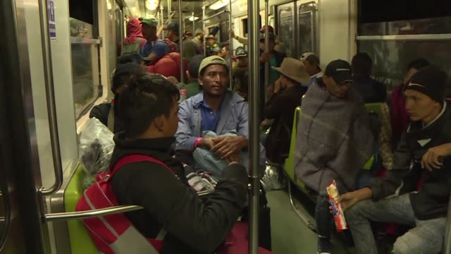 Hundreds of Central American migrants take the metro in Mexico City after local authorities allowed them to travel on especially dedicated wagons for...