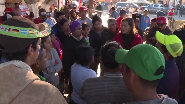 hundreds of central american migrants who tried to force through a mexican police blockade into the united states retreat to a nearby camp - mexican american stock videos & royalty-free footage