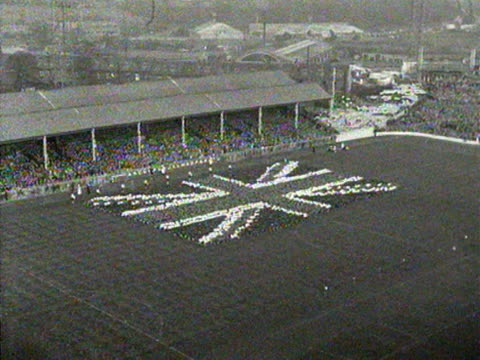 hundreds of children form the shape of a union jack flag at the hillsborough football stadium for the queen's visit to sheffield. - hillsborough stadium stock videos & royalty-free footage