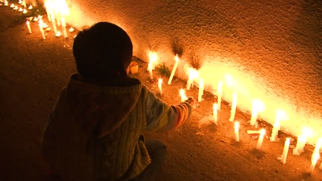 hundreds of chileans hold a candlelight vigil in front of santiago's national stadium paying tribute to the missing victims of augusto pinochet's... - memorial event stock videos and b-roll footage