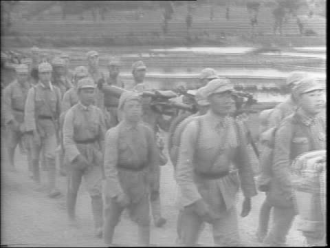 hundreds of chinese ground troops destroy road making the road unpassable by digging deep holes using picks by hand / long line of hundreds of... - allied forces stock videos & royalty-free footage