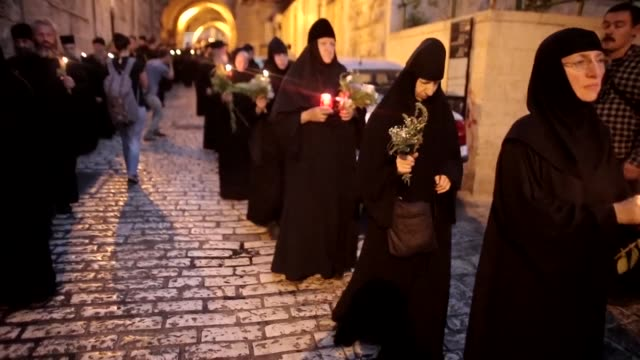 stockvideo's en b-roll-footage met hundreds of christian orthodox clergy and pilgrims took part in a religious procession marking the dormition of the theotokos which commemorates the... - bedevaart