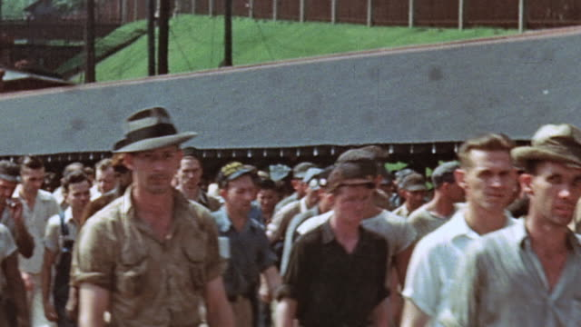 hundreds of civilian workers leaving the shipyard after work / newport news virginia united states - dockarbeiter stock-videos und b-roll-filmmaterial