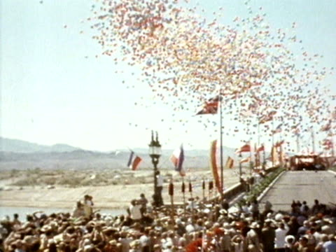 hundreds of coloured balloons are released during the opening ceremony of the newly rebuilt london bridge at lake havasu city. october 1971. - rebuilding stock videos & royalty-free footage