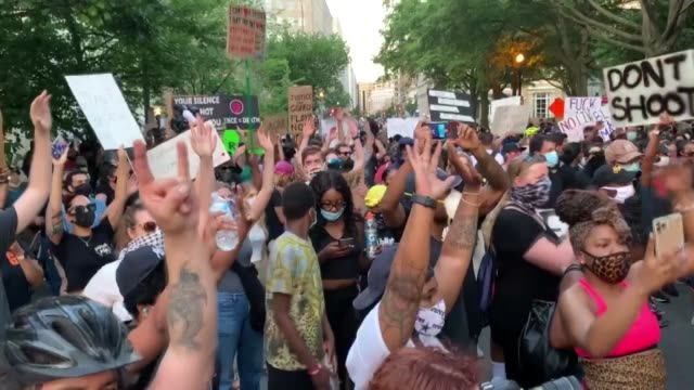 hundreds of demonstrators gathered at lafayette park across from the white house to protest the death of george floyd an unarmed black man who died... - lafayette square washington dc stock videos & royalty-free footage