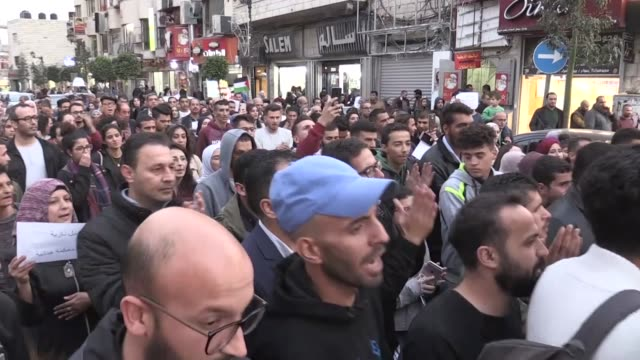 hundreds of demonstrators stage a protest against israeli attacks on gaza in ramallah west bank on november 13 2018 - gaza strip stock videos & royalty-free footage