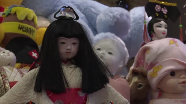 hundreds of dolls from hello kitty to disney favourites are packed to the ceiling at a funeral home near tokyo - hello kitty stock videos and b-roll footage