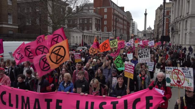 "hundreds of extinction rebellion climate crisis protestors march through the capital on the ""enough is enough"" demonstration - protestor stock videos & royalty-free footage"