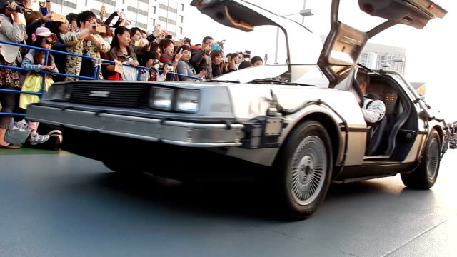 "hundreds of fans have celebrated the ""back to the future"" day with an electric delorean on october 21, 2015 in tokyo, japan. - macchina del tempo video stock e b–roll"