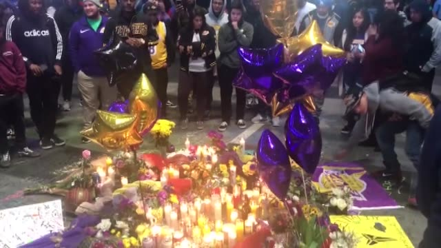 hundreds of fans take part in a vigil for former nba star kobe bryant in front of staples center home of the los angeles lakers on january 26 2020 in... - staples center video stock e b–roll