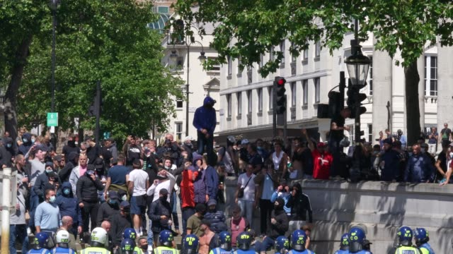 hundreds of farright protesters break the police lines to gather in trafalgar square on june 13 2020 in london united kingdom following a social... - abundance stock videos & royalty-free footage