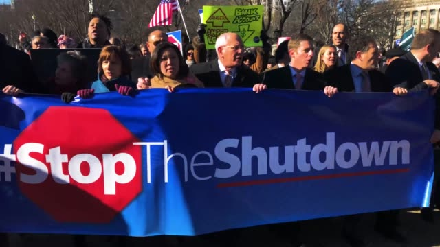 hundreds of federal workers and contractors rally against the partial federal government shutdown outside the headquarters of the afl-cio january 10,... - government shutdown stock videos & royalty-free footage