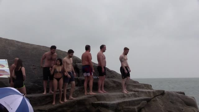 hundreds of festive swimmers braved the irish sea for the traditional christmas day dip in dublin heavy rainfall failed to dampen the mood at the... - swimming stock videos & royalty-free footage