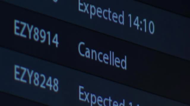 hundreds of flights cancelled ahead of storm dennis; uk, gatwick airport; gvs airport terminal and travellers, vox pops with delayed passengers.... - ガトウィック空港点の映像素材/bロール