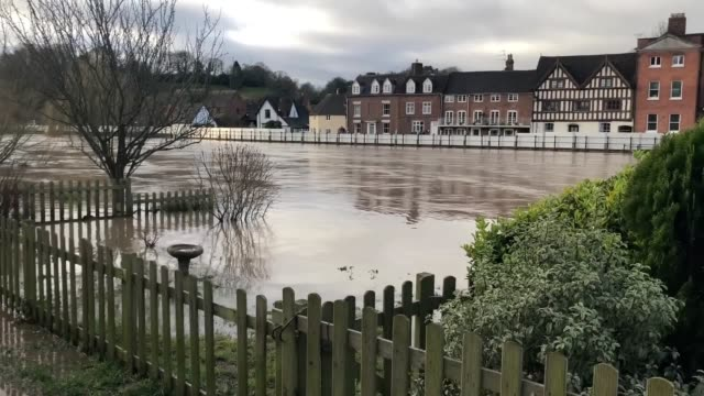 hundreds of flood alerts remain in place across britain after storm dennis battered the country, with one woman feared missing after being swept away... - herefordshire stock videos & royalty-free footage