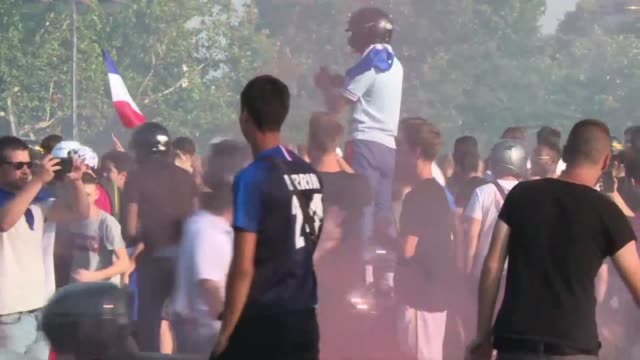 hundreds of french supporters gather on the champs elysees in paris to celebrate their team's victory in the world cup quarter finals - international team soccer stock videos & royalty-free footage