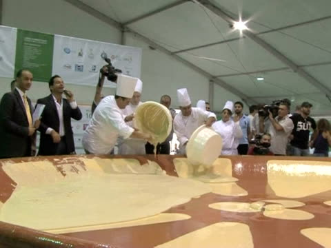 hundreds of garlic-loving lebanese came together on saturday to make the largest hummus serving on the world's biggest plate, claiming ownership of... - biggest stock videos & royalty-free footage