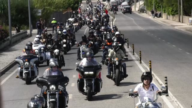 PRT: Harley-Davidson motorcycles parade takes place in Lisbon
