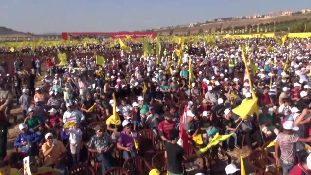 hundreds of hezbollah supporters were marking the 11th anniversary of the end of the 2006 war with israel sunday in sahel elkhiam lebanon - hezbollah stock videos & royalty-free footage