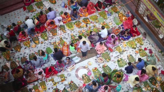 hundreds of hindu devotees sits with prodip and prays to god in front of shri shri lokanath brahmachari ashram temple during the kartik brati or... - hinduism stock videos & royalty-free footage