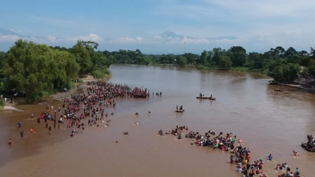hundreds of hondurans cross a river into mexico in a fresh wave of migrants heading to the united states after mexican authorities refused to open a... - guatemala stock videos & royalty-free footage