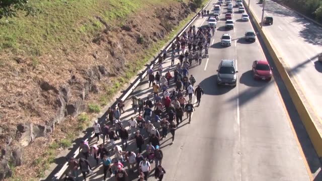 hundreds of hondurans set out on a trek to the united states forming another caravan that us president donald trump has cited to justify building a... - national border stock videos & royalty-free footage