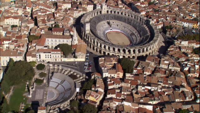 hundreds of houses surround a roman amphitheater in provence. - amphitheater stock videos & royalty-free footage