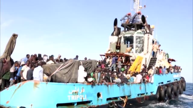 hundreds of illegal migrants, consisting of mostly africans, were captured by libyan coast guards in the mediterranean sea while trying to go to... - 2015 stock-videos und b-roll-filmmaterial