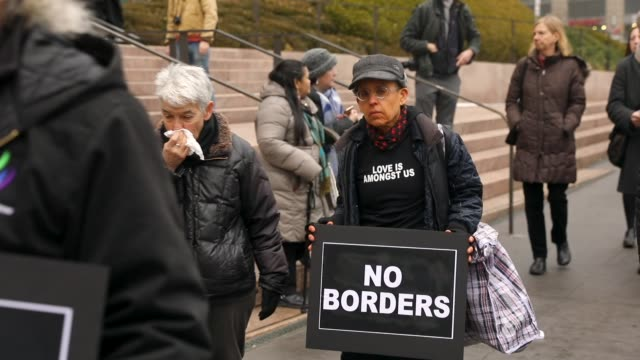 hundreds of immigration activists, clergy members and others participate in a protest against president donald trump's immigration policies in front... - mexican american stock videos & royalty-free footage