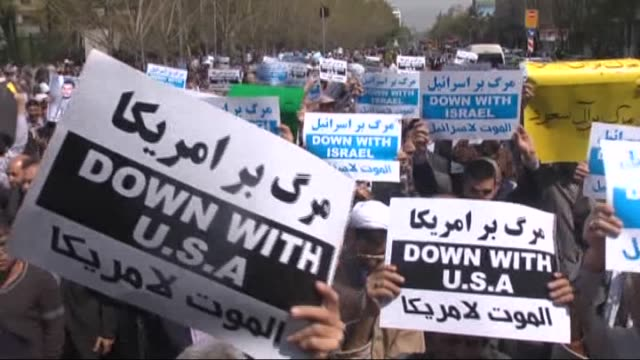 hundreds of iranians chant slogans against the united states and saudi arabia during a demonstration in support of the yemenis following the friday... - teheran stock videos & royalty-free footage