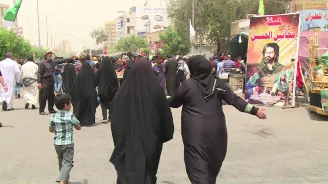 hundreds of iraqi pilgrims were walking wednesday towards kadhimiya in northwestern baghdad to worship at the shrine of imam musa ibn jaafar kadhim,... - shi'ite islam stock videos & royalty-free footage