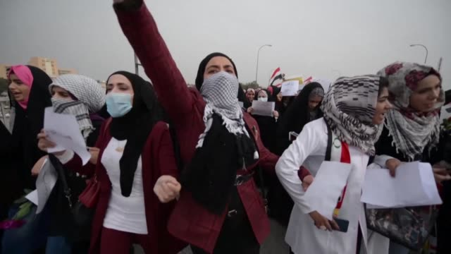 hundreds of iraqi women stage a march in the shiite holy city of najaf insisting on their right to play a central role in the protest movement... - najaf stock videos & royalty-free footage