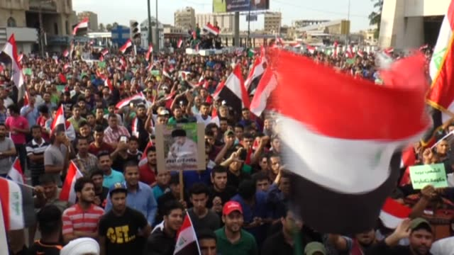 hundreds of iraqis gather at the tahrir square to stage a protest demanding the foundation of the technocrat government and the resignation of the... - prime minister stock videos & royalty-free footage